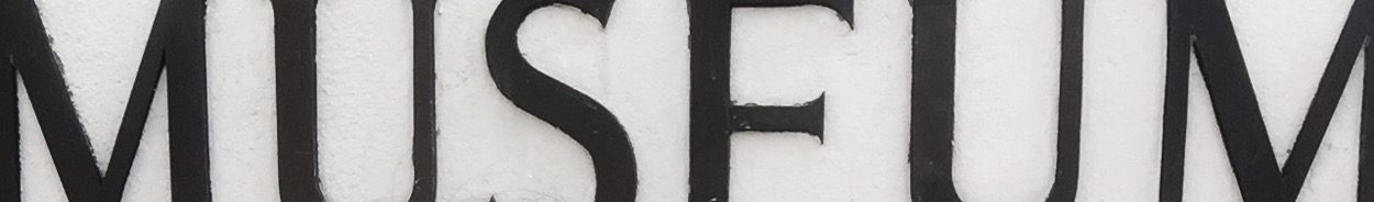 Closeup of the second Spielzeugmuseum sign where I cropped out just the word museum